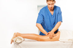Physical therapist doing massage on woman hip Stock Photography