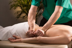 Physical therapist doing medical massage. Close-up of physical therapist doing medical massage Royalty Free Stock Photos