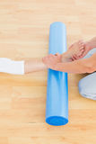 Physical therapist examining a womans leg Stock Photo