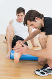 Physical therapist examining a young mans leg Royalty Free Stock Photo