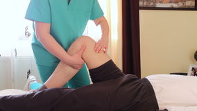 Physical therapist giving a knee massage stock video footage