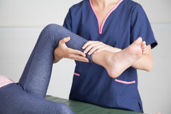 Physical Therapist giving a leg treatment Stock Photo