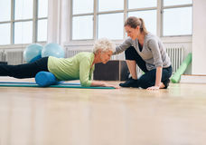 Physical therapist helping elderly woman in her workout Stock Image