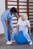 Physical Therapist helping a Patient Stock Images