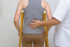 Physical therapist helps a patient rehab to walk Royalty Free Stock Photo