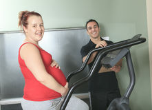 Physical therapist jogging ,pregnant woman Stock Photography