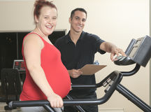 Physical therapist jogging ,pregnant woman Stock Images