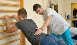 Physical therapist kinetotherapy. And pacient Royalty Free Stock Photos