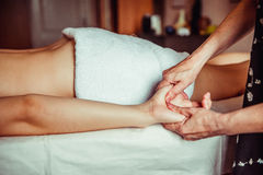 Physical therapist massaging hands Stock Image