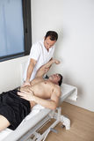 Physical therapist with patient applying osteopathy Royalty Free Stock Photography