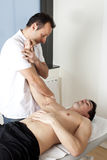 Physical therapist with patient applying osteopathy Royalty Free Stock Photo