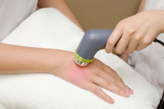 Physical therapist using ultrasound probe on woman patient 's ha Royalty Free Stock Image