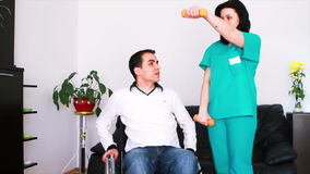 Physical therapist working with patient Stock Images