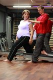 Physical therapist working with pregnant woman Stock Photos