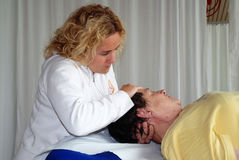 Physical therapy. SAALFELDEN, AUSTRIA - AUGUST 30: physical therapist exercising with senior rheumatism patient on August 30, 2007 at rehabilitation center in Stock Photo