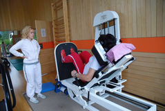 Physical therapy. SAALFELDEN, AUSTRIA - AUGUST 30: physical therapist assisting female patient on August 30, 2007 at rehabilitation center in Saalfelden, Austria Stock Photography