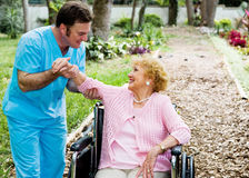 Physical Therapy. Beautiful disabled senior woman receiving physical therapy in an outdoor setting Stock Images