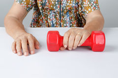 Physical Therapy ,elderly exercises with dumbbell Royalty Free Stock Images