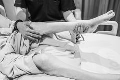 Physical therapy exercises for elderly patient`s leg. In hospital royalty free stock photos