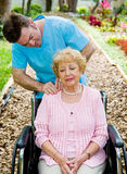 Physical Therapy - Massage. Senior woman in wheelchair receives massage therapy from a physical therapist Royalty Free Stock Photo