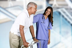 Physical Therapy. Nurse giving physical therapy to an elderly patient stock photography