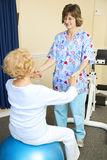 Physical Therapy Session. Senior woman exercises with the help of a physical therapist Royalty Free Stock Photography
