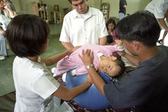 Physical therapy for spastic Filipino girl Royalty Free Stock Photos