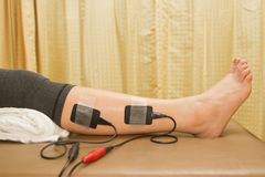Physical therapy , woman with eletrical stimulator Royalty Free Stock Photos