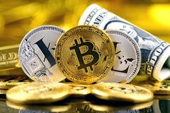 Physical version of Bitcoin and Litecoin new virtual money and banknotes of one dollar. Royalty Free Stock Photos