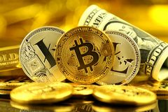Physical version of Bitcoin and Litecoin new virtual money and banknotes of one dollar. Royalty Free Stock Photo
