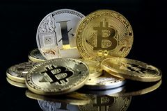 Physical version of Bitcoin and Litecoin new virtual money on banknotes of one dollar. Royalty Free Stock Image