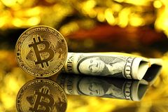 Physical version of Bitcoin new virtual money and banknotes of one dollar. Royalty Free Stock Photo