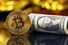Physical version of Bitcoin new virtual money and banknotes of one dollar. Royalty Free Stock Images