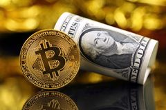 Physical version of Bitcoin new virtual money and banknotes of one dollar. royalty free stock photos