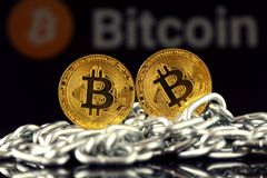 Physical version of Bitcoin new virtual money and chain. Stock Photo