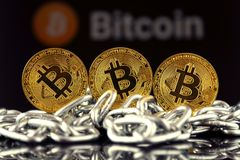 Physical version of Bitcoin new virtual money and chain. Royalty Free Stock Photo