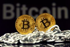 Physical version of Bitcoin new virtual money and chain. Royalty Free Stock Photos