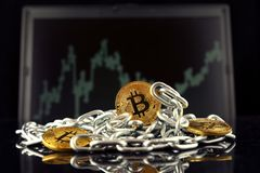 Physical version of Bitcoin new virtual money and chain. Stock Photography