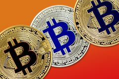 Physical version of Bitcoin new virtual money with colorful effect. Closeup on Physical version of Bitcoin new virtual money with colorful effect Royalty Free Stock Photo