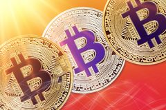 Physical version of Bitcoin new virtual money with colorful sunburst effect. Closeup on Physical version of Bitcoin new virtual money with colorful sunburst Royalty Free Stock Photos