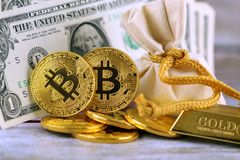 Physical version of Bitcoin, new virtual money. Royalty Free Stock Image