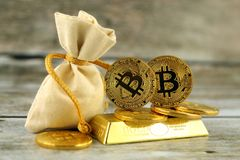 Physical version of Bitcoin, new virtual money. Conceptual image for investors in cryptocurrency and gold Stock Images