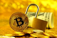 Physical version of Bitcoin new virtual money, golden padlock and banknotes of one dollar Stock Images