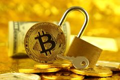 Physical version of Bitcoin new virtual money, golden padlock and banknotes of one dollar. Stock Image