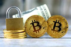 Physical version of Bitcoin new virtual money, golden padlock and banknotes of one dollar. Royalty Free Stock Images