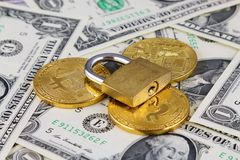 Physical version of Bitcoin new virtual money, golden padlock and banknotes of one dollar. Stock Photography