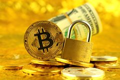Physical version of Bitcoin new virtual money, golden padlock and banknotes of one dollar. Royalty Free Stock Photo