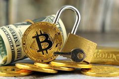 Physical version of Bitcoin new virtual money, golden padlock and banknotes of one dollar. Royalty Free Stock Photography
