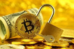 Physical version of Bitcoin new virtual money, golden padlock and banknotes of one dollar. Royalty Free Stock Image
