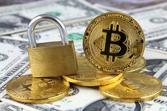Physical version of Bitcoin new virtual money, golden padlock and banknotes of one dollar. Royalty Free Stock Photos